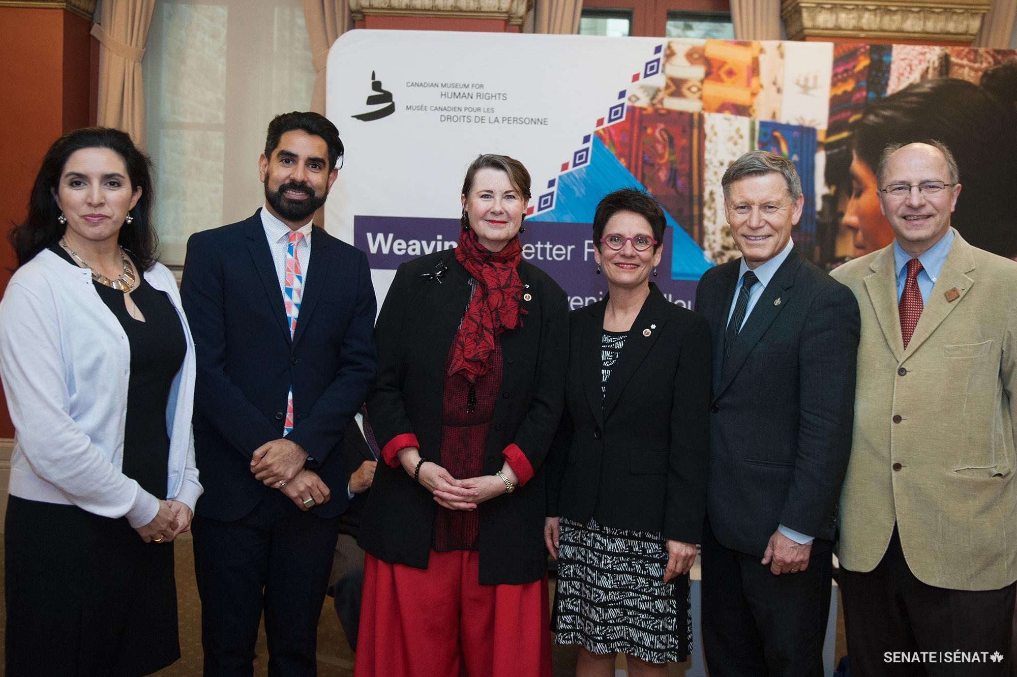 Viviana Fernandez, Armando Perla, Hon. Marilou McPhedran, Hon. Raymonde Gagné, Parliamentary Secretary Terry Duguid M.P. & John Packer