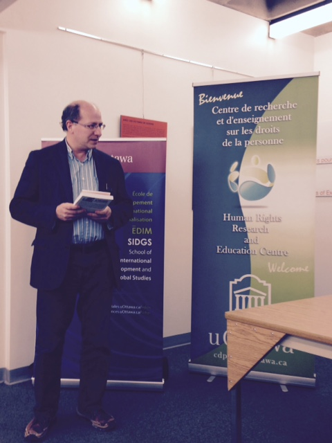 Director John Packer welcomes participants to the book launch