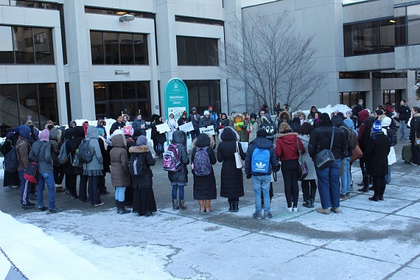 Students gathered in front of the Morisset Library.